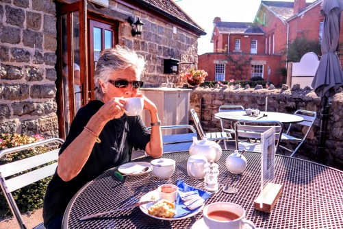 Bev enjoying her tea on the pation in the sun.